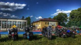 摩托车和美丽的天空与云彩 库存照片