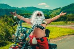 摩托车圣诞老人 免版税库存照片