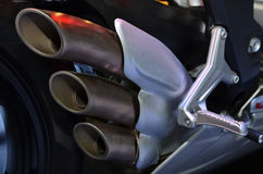 摩托车尾气 库存图片