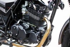 黑摩托车引擎,摩托车引擎细节在白色背景的 图库摄影