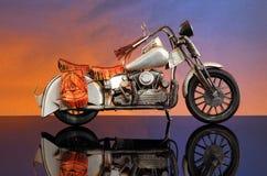 摩托车日落 免版税库存照片