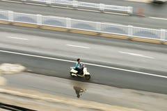 摩托车的一个人 免版税图库摄影