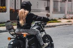 摩托车的2女孩 免版税库存图片