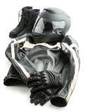 摩托车盔甲、手套、夹克和起动 免版税图库摄影