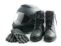 摩托车盔甲、手套和起动 免版税库存图片