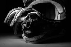 摩托车越野赛盔甲和手套 免版税图库摄影