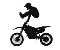 摩托车越野赛车手剪影  免版税库存图片