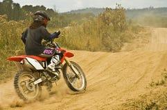 摩托车越野赛车手妇女 图库摄影