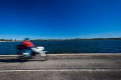 摩托车速度迷离蓝色盐水湖路 库存照片