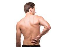 摩擦他痛苦的后面的人 镇痛,按摩脊柱治疗者概念 免版税图库摄影