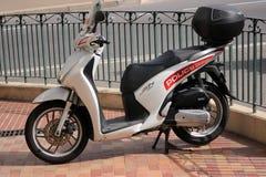 摩纳哥警察的本田嘘125i摩托车 免版税库存图片