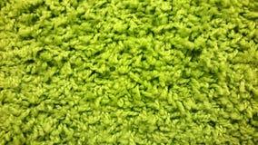 撒石灰地毯,毛线,绿色织品背景纹理  库存照片