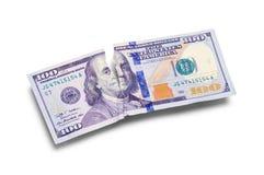 撕毁一百元钞票 免版税库存图片