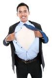 撕毁他的衬衣的年轻商人 免版税库存照片