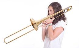 播放伸缩喇叭的十几岁的女孩 免版税库存照片