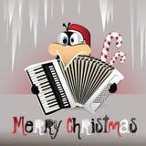 播放手风琴的圣诞快乐企鹅 库存图片