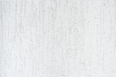 播种紧密detailes看法照片在房子墙壁上的 关闭抽象镶边白色灰泥纹理和后面照片  库存图片