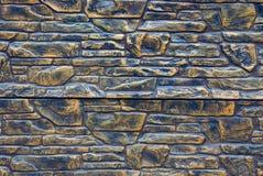 操刀大厦的一个棕色石墙的纹理 库存图片