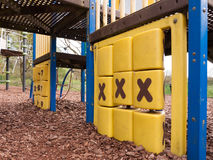操场公园儿童` s玩具横渡和与三x的零 免版税库存照片