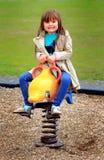 操场玩具的小女孩 库存图片