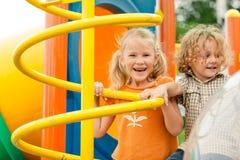 操场的两个愉快的孩子 库存照片