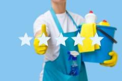 擦净剂在服务上的五个星水平显示 免版税库存图片