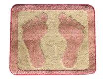 擦鞋垫脚孤立 库存照片