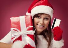 支付圣诞节礼物 免版税库存照片