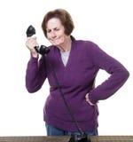 收到推销电话的妇女 库存图片