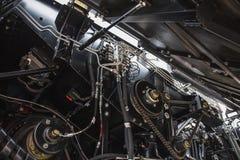 收割机引擎,齿轮链子,新的现代技术组合机制传输  免版税库存图片