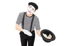 收在帽子的笑剧艺术家金钱 库存图片