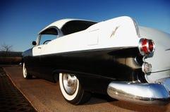 一辆经典汽车的后方 免版税库存图片