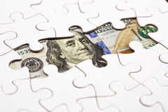 收集与七巧板的美元钞票 免版税库存图片