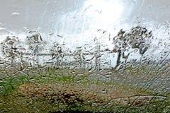 收集丢弃本质雨视窗 免版税库存图片