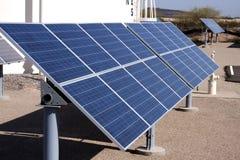 收集器能源太阳农厂的面板 免版税库存照片