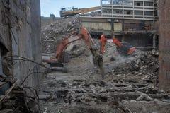 收集爆破挖掘机的大瓦砾站点 库存图片