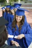 收集证明的女性毕业生从教务长 免版税库存照片