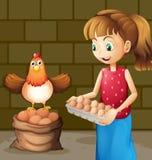 收集鸡蛋的农夫的妻子 免版税库存图片