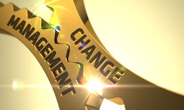 改变管理概念 金黄金属齿轮 3d 免版税库存图片