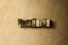 改变-脏的葡萄酒特写镜头排版了在金属背景的词 免版税库存图片