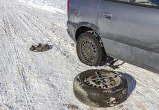 更改的泄了气的轮胎 库存照片