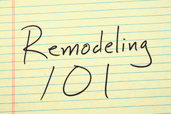 改造101在一本黄色便笺簿 免版税库存照片