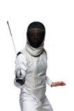 攻击的姿势的妇女击剑者 库存图片
