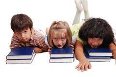 放下在书的三子项查出 免版税图库摄影