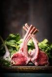 放在架子上的羊羔在土气厨房用桌上的在木背景 免版税库存图片