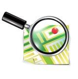 放大镜和旅行地图 免版税库存照片