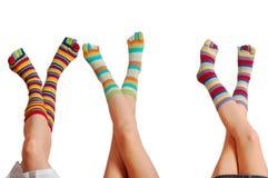 放松三婴孩,袜子的许多颜色 免版税库存图片