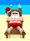 放松圣诞老人的海滩JPG 库存图片