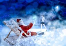 放松在晚上的圣诞老人 库存照片