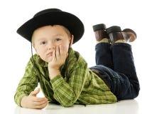 放松牛仔的孩子 免版税库存图片